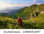 the view with the high rocky... | Shutterstock . vector #1084051097