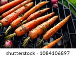 grilled carrots in a herbal... | Shutterstock . vector #1084106897