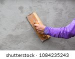 Small photo of Workers are plastered walls. Hands plasterer at work. Application of the plaster on the wall.
