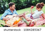 picnic time. young couple... | Shutterstock . vector #1084285367