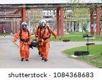 three professional firefighter... | Shutterstock . vector #1084368683