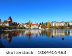 buildings reflection in the... | Shutterstock . vector #1084405463