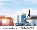 businessman walking blindfolded ... | Shutterstock . vector #1084474373