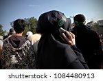 an activist attends a rally to... | Shutterstock . vector #1084480913