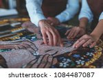 human hands with mosaic in... | Shutterstock . vector #1084487087