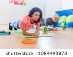 sporty attractive young females ... | Shutterstock . vector #1084493873