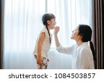 mother feeding snack to... | Shutterstock . vector #1084503857