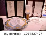 served table  with menu on it | Shutterstock . vector #1084537427