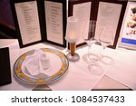 served table  with menu on it | Shutterstock . vector #1084537433