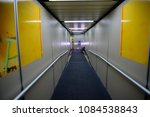 tunnel leading to the aircraft... | Shutterstock . vector #1084538843
