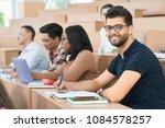 sideview of arabian student... | Shutterstock . vector #1084578257