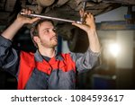 auto mechanic working at auto... | Shutterstock . vector #1084593617