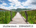 wooden path with mountain and... | Shutterstock . vector #1084606913