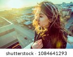 beautiful girl sitting on the... | Shutterstock . vector #1084641293