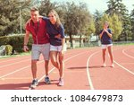 young athlete injured to knee... | Shutterstock . vector #1084679873