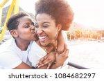 happy young mother having fun... | Shutterstock . vector #1084682297