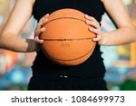 young woman holding a basketball | Shutterstock . vector #1084699973