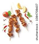 pork shish kebab isolated on... | Shutterstock . vector #1084708607