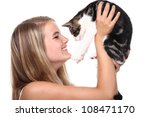 Beautiful woman with a cat - stock photo