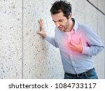 man having a sudden heart...   Shutterstock . vector #1084733117