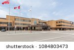 Small photo of Toronto, Ontario, Canada - May 05, 2018: Bombardier Aerospace building at downsview area, a division of Bombardier Inc. Bombardier selling Downsview property.