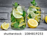 lemon and herb detox water in a ... | Shutterstock . vector #1084819253