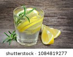 tasty beverage with lemon and... | Shutterstock . vector #1084819277