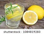 tasty cool beverage with lemon... | Shutterstock . vector #1084819283