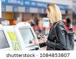 casual caucasian woman using... | Shutterstock . vector #1084853807