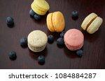 top view of macaroons on wooden ... | Shutterstock . vector #1084884287