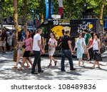 PARIS, JUL 22: The official mobile shop of Le Tour de France is parked on the Champs Elysees boulevard in Paris. It sells specific souvenirs during the last stage of Le Tour de France on 22 July 2012 - stock photo