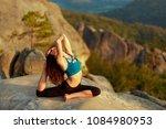 yoga process. flexible young... | Shutterstock . vector #1084980953