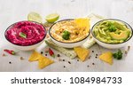 colorful hummus  different dips ... | Shutterstock . vector #1084984733
