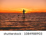 surfer woman stand up paddle...   Shutterstock . vector #1084988903