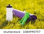 sports accessories on the grass ... | Shutterstock . vector #1084990757