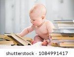 a little boy is looking at a... | Shutterstock . vector #1084991417
