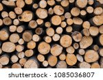pile of wood logs ready for... | Shutterstock . vector #1085036807