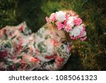 young blonde girl in a flower... | Shutterstock . vector #1085061323