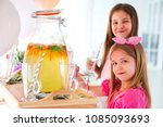 kids by the candy bar with cake ... | Shutterstock . vector #1085093693