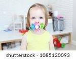 cute 2 years little girl suckle ... | Shutterstock . vector #1085120093