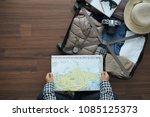 overhead view of traveler woman ... | Shutterstock . vector #1085125373