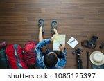 overhead view of traveler man... | Shutterstock . vector #1085125397