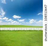 White Fences On Green Grass
