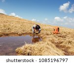 man drinking water from stream. ... | Shutterstock . vector #1085196797