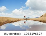 cheerfull hiker running on the... | Shutterstock . vector #1085196827