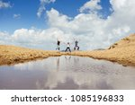 three hiker friends jump... | Shutterstock . vector #1085196833