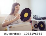 young audiophile enjoy music  | Shutterstock . vector #1085196953