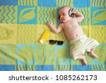 little baby lying on a big... | Shutterstock . vector #1085262173