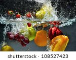 Splashing Fruit On Water. Fres...