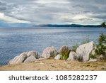 rocky seashore in croatia on a... | Shutterstock . vector #1085282237